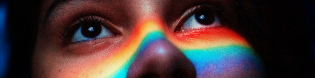 person with a prism reflected on their nose