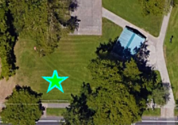 overhead map view with a star marking the location of the memorial tree