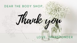"""a white thank you card with vases of baby's breath in the background. Text reads, """"Dear The Body Shop, Thank you, Love TransPonder."""""""